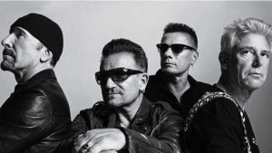 u2 y Bono  toca bateria